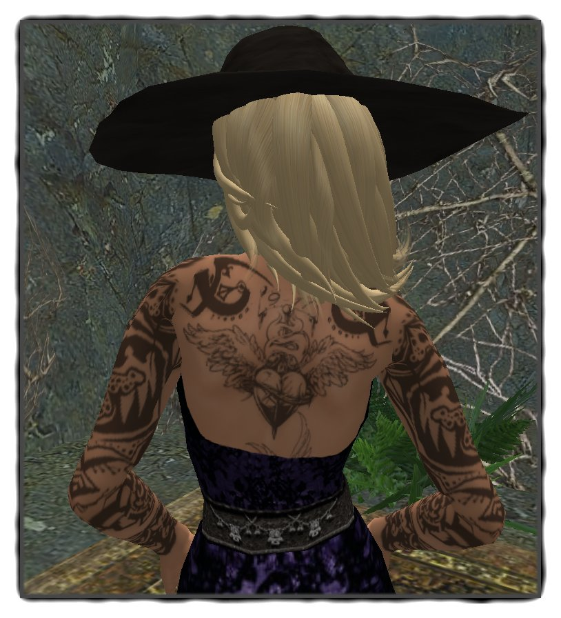 The beautiful tattoo is from Inflict. Hat with hair: Frangipani Designs